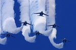 Japan_air_self_defense_force_Kawasaki_T-4_Blue_Impulse_RJAH_Wide_to_Delta_Loop.jpg